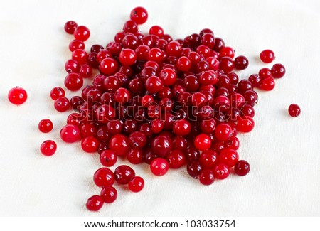 Cranberries on a linen tablecloth. Healthy vitamin food
