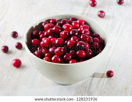 Cranberries on wooden table