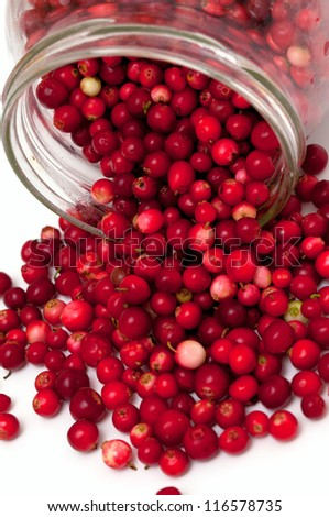 cranberries spilling from glass jar