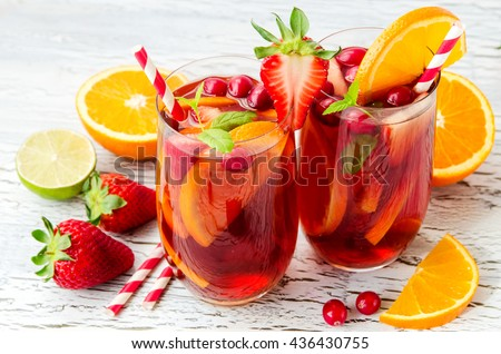 Cranberry drink, homemade lemonade or sangria with citrus fruits and berries on white background, refreshing cocktail for hot summer days #436430755