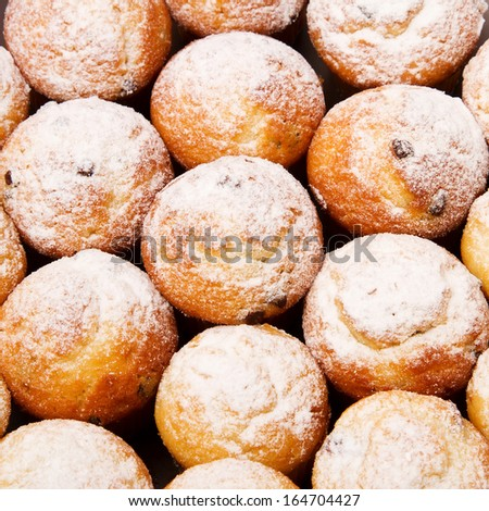 Cranberry muffins covered with powdered sugar