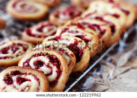 Cranberry nut swirl cookies cooling on rack.  (Selective focus)