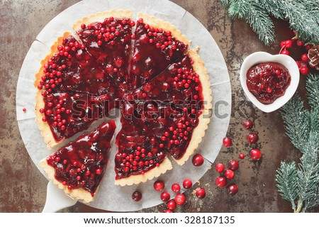 Cranberry Tart. Delicious cranberry tart with jellied and fresh cranberries for Christmas. Top view, vintage toned #328187135