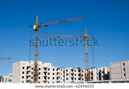 crane and building under construction on the skyline