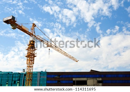 Crane and building working progress - stock photo