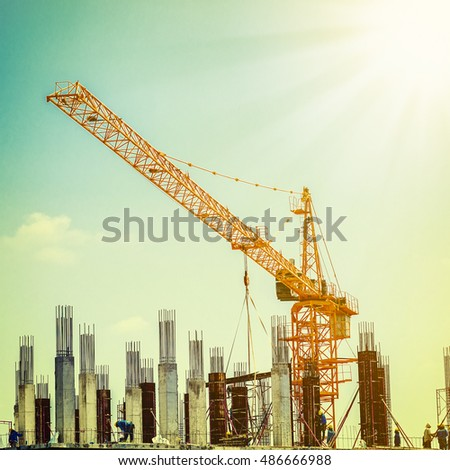 crane and workers at...