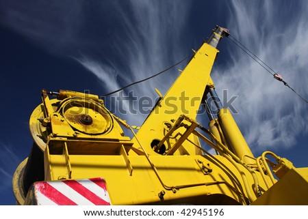 crane arm against a blue sky