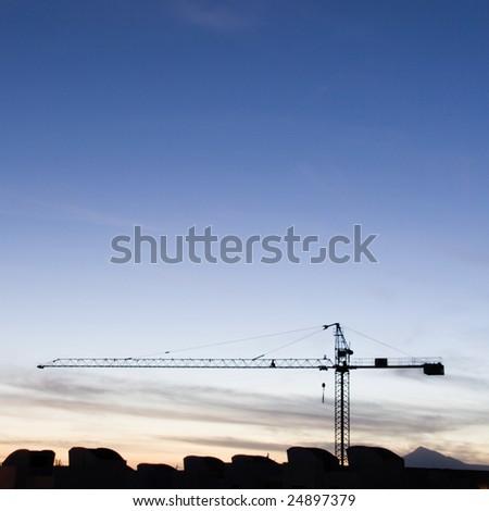crane at a blue sunset