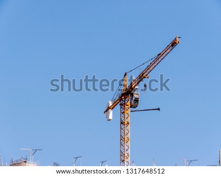 Crane carries steel beams in the work of a building in Sao Paulo #1317648512