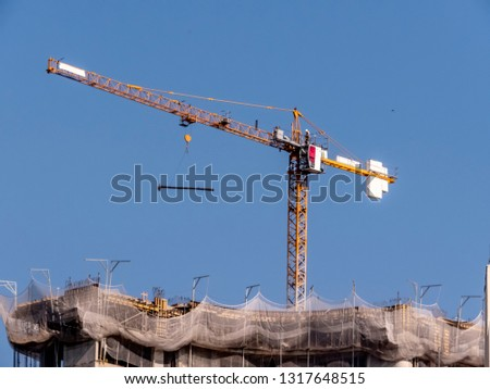 Crane carries steel beams in the work of a building in Sao Paulo #1317648515