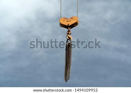 crane chain detail in sky background detail