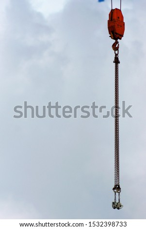 crane hook isolated chains on sky background lifting heavy duty