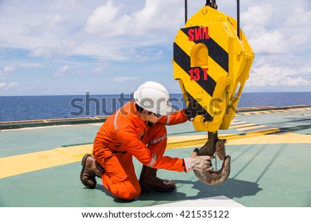 Crane inspector, crane inspector on the job  inspec crane hook