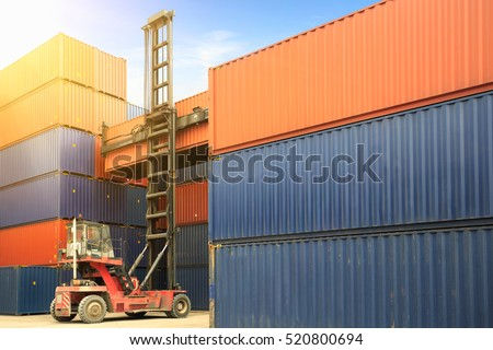 Crane lifting up container in yard, control loading Containers box from Cargo freight ship, Forklift handling container box loading to truck in import export logistic