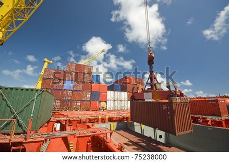 crane lifts container during cargo operation in port