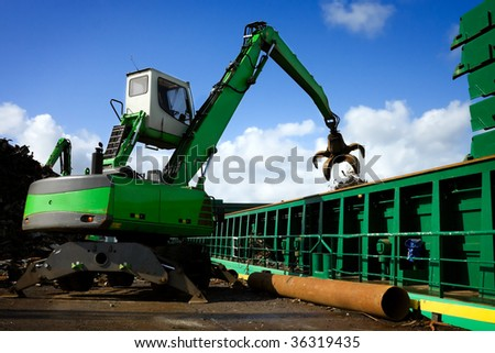 Crane Loading A Ship With Recycling Steel