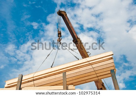crane loading timber on pallet