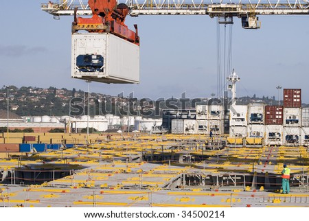 crane lowering container to stack of containers, Durban, South Africa