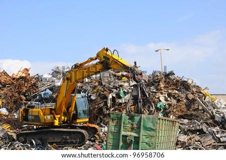 Crane picking up garbage
