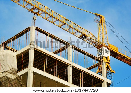 Crane. Self-erection crane over construction site. Crane near bulding. Stockfoto ©