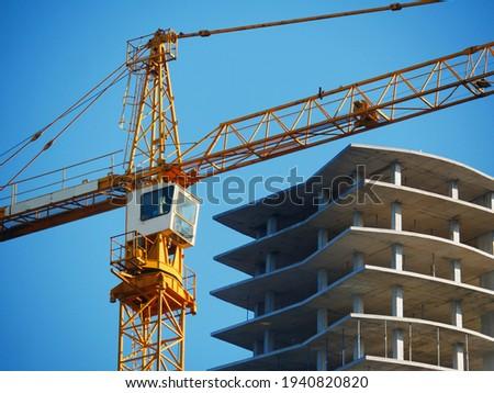Crane. Self-erection crane over construction site. Crane near bulding. Industrial background. Сток-фото ©