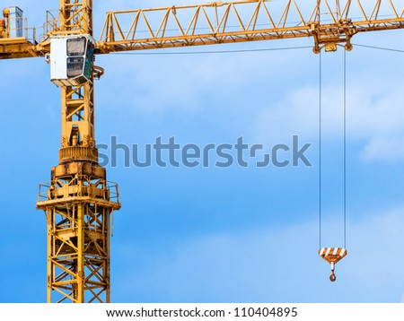 Crane up in the blue sky operating saturated color