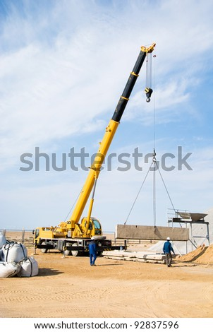 crane work on construction site - stock photo