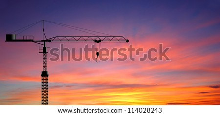 Crane working construction for business industrial and sunset background for design