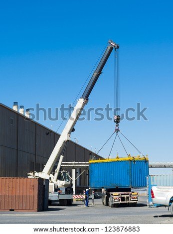 Crane works. Container loading on the truck