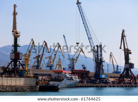 cranes and ships in a port.