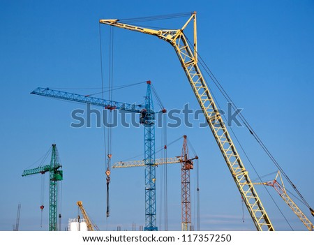 Cranes at a construction site of a new residential area