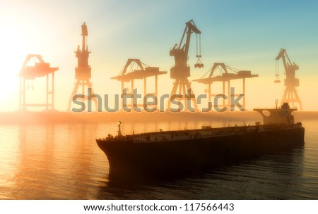 Cranes at a port in the evening