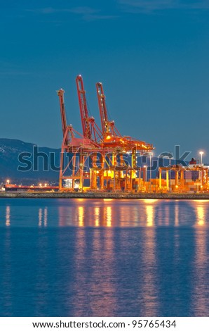 Cranes at the container port terminal dawn (night) time in Vancouver BC