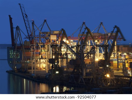 cranes at the container port terminal in Odessa sunset time