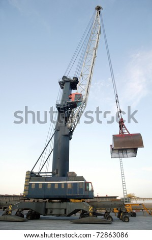 Cranes in a seaport, unloading a ship