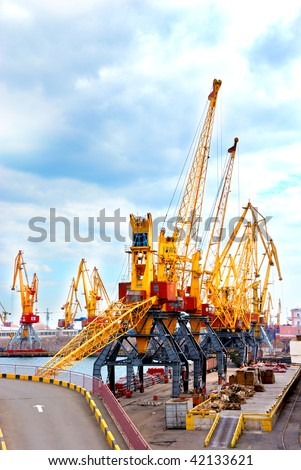 cranes in port on a mooring