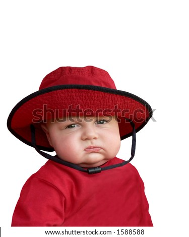 Cranky baby in red hat.