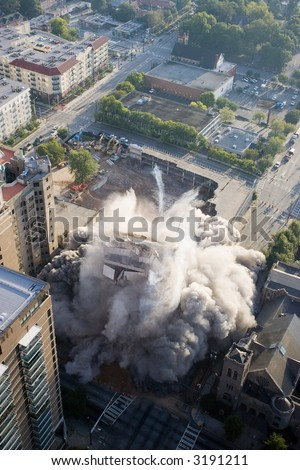 crash implode implosion building fall ground explosion tumble architecture smoke bomb demolition overhead - stock photo