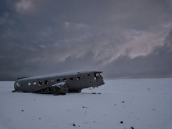 Crashed plane on a snowy field. Photo from March in Iceland