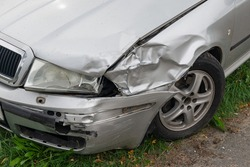 Crashed silver car front fender insurance accident broken collision damage bumper