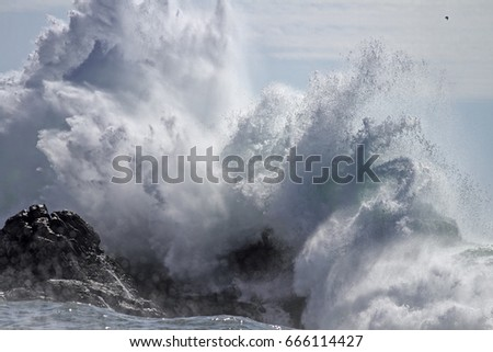 Crashing big sea wave against rocks splash and spray.  #666114427