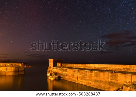 Craster Harbour at Night / Stars above Craster Harbour at night, on the Northumberland Coast, with just a hint of the Aurora Borealis #503288437