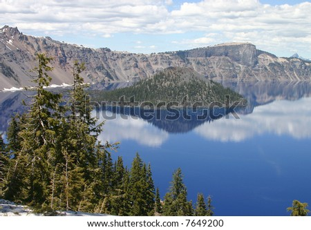 Crater Lake with a nice cloudy blue sky.