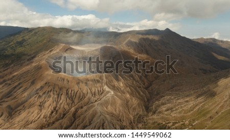 Crater with active volcano smoke in East Jawa, Indonesia. Aerial view of volcano crater Mount Gunung Bromo is an active volcano,Tengger Semeru National Park.