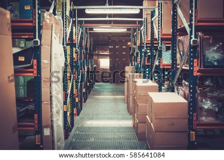 Crates and boxes on a shelves in a warehouse