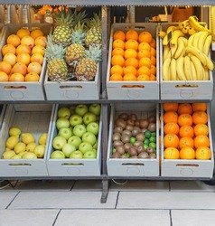 Crates with fresh fruits in juice bar