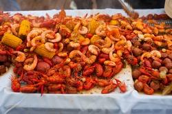 Crawfish boils. Louisiana, New Orleans Crawfish Boil. Crawfish, shrimp, lobster, seafood, corn on the cob, sausage, potatoes boiled in Cajun seasonings and herbs. Classic Cajun or Creole cuisine.