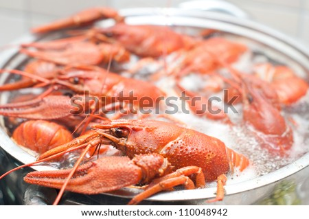 crawfish cooking in a large pot