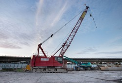 Crawler crane at construction site on blue sky background