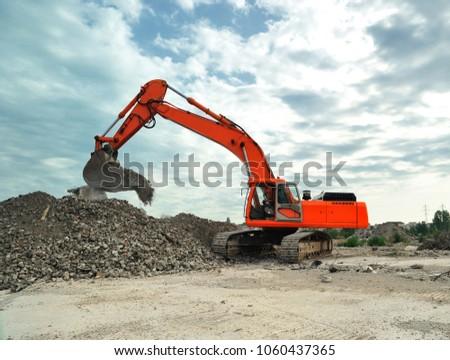 Crawler excavator on construction site. Isolated big crawler excavator working on construction site.